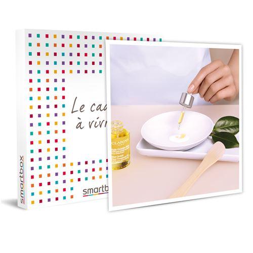 SMARTBOX - Pause Bien-être en Boutique & Spa Clarins : soin visage et 20€ de bon d'achat sur les produits Clarins - Coffret Cadeau