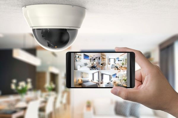 mobile-connect-with-security-camera-picture-id871704344